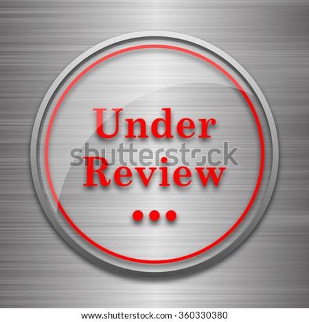 Under review icon. Internet button on metallic background.  - stock photo