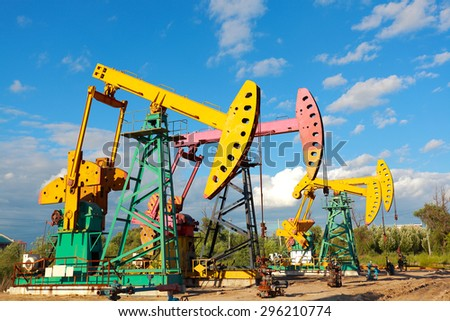Under sunny golden yellow and pink Oil pump oil rig energy industrial machine for petroleum crude  - stock photo