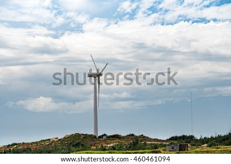 Under the background of wind power in the blue sky white clouds