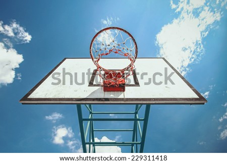 under the basketball ring and blue sky background - stock photo