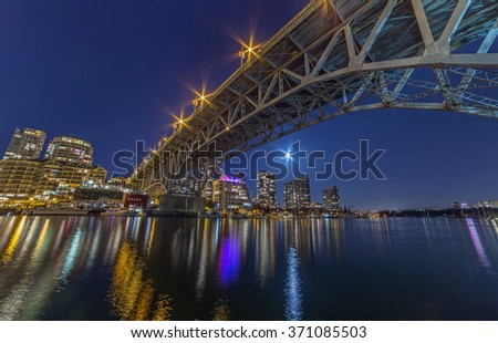 Under the Granville Street Bridge at night in Vancouver