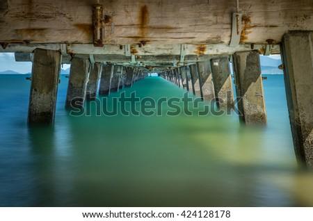 Under the jetty Picnic Bay, Magnetic Island, Australia, long exposure - stock photo