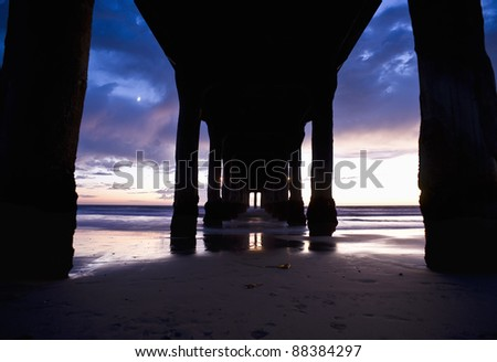 Under the Manhattan Beach Pier - stock photo
