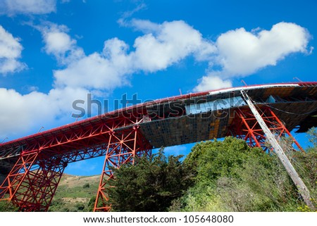 Under the San Francisco Golden Gate Bridge.  Looking up from below at the support structure of the approach to the bridge. - stock photo