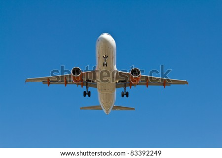 Under view of an airplane coming into land - stock photo