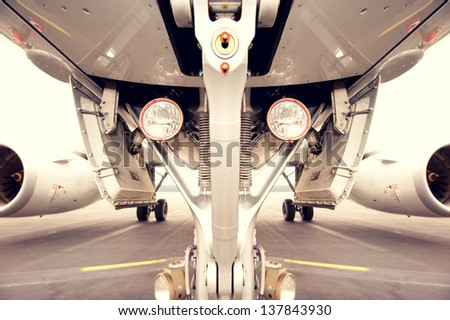Undercarriage of jet plane, aircraft - symmetrical - stock photo