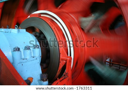 Underground mining pulley rotating - stock photo