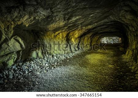 underground natural tunnel - stock photo