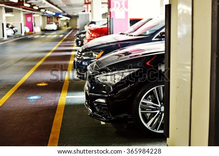 Underground parking zone, full of  the cars - stock photo