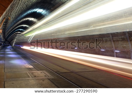 Underground railroad with  moving train, transporation. - stock photo