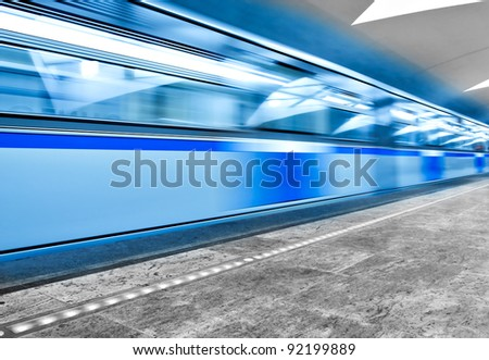 underground station and blue moving train