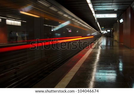 underground train in bucharest leaving station with motion blur - stock photo