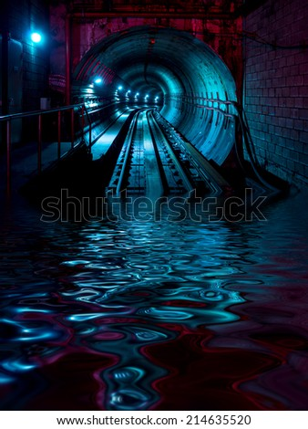 Underground train tunnel floods with water - stock photo