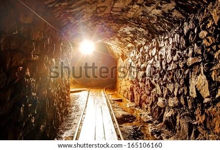 Underground tunnel in mine - stock photo
