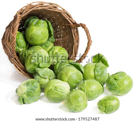 underlying basket with brussel sprouts  spilling on a white