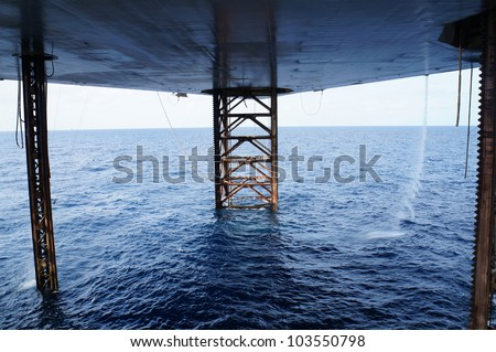 Underneath Jack Up Drilling Rig In The Ocean - Oil and Gas Industry - stock photo