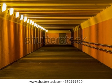Underpass, whose walls are painted in orange - stock photo