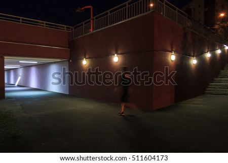 Underpass with lamps, staircase, passage, people, angle