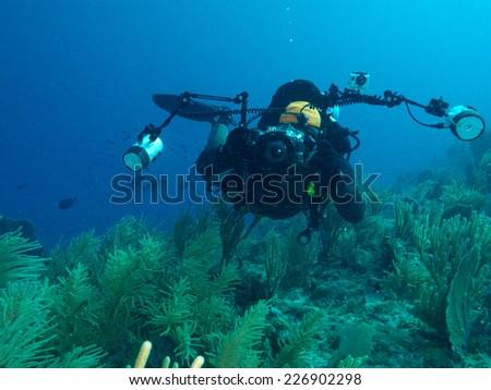 undersea photographer - stock photo
