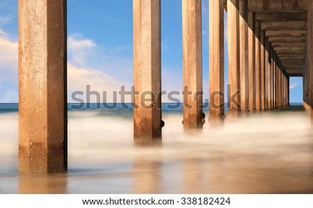 Underside of a pier, view of pylons,  in San Diego California, Scripps Pier - stock photo