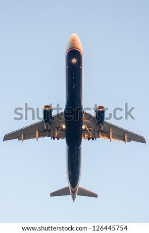 Underside of airliner - stock photo