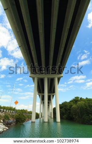 Underside view of the Florida Keys US1 Highway bridge. - stock photo