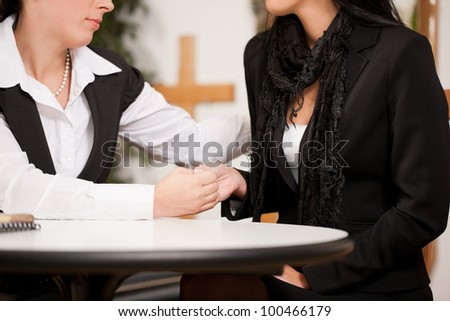 Undertaker is advising a client for the funeral and is giving her solace