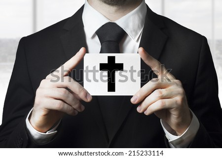 undertaker man holding sign black cross funeral - stock photo