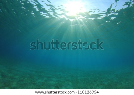 Underwater Background of Sun, Sea and Sand - stock photo