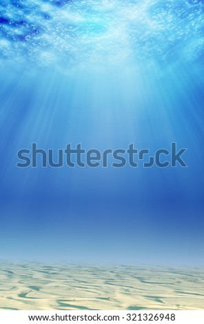 underwater background with sand and sunlight - stock photo