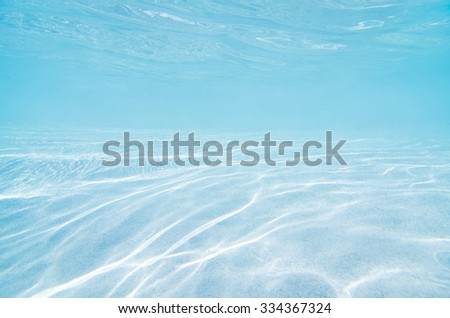 underwater background with sandy sea bottom - stock photo