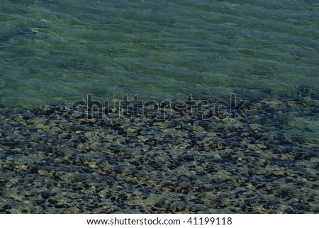 Underwater Beach Pebbles - stock photo