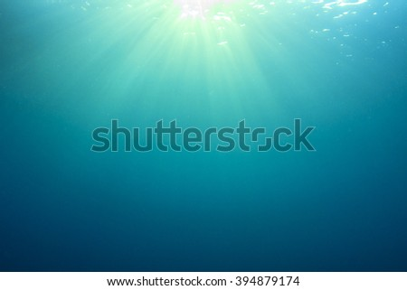 Underwater blue ocean background with sunlight in sea - stock photo