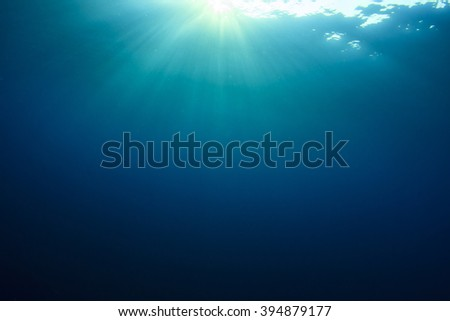 Underwater blue ocean background with sunlight in sea