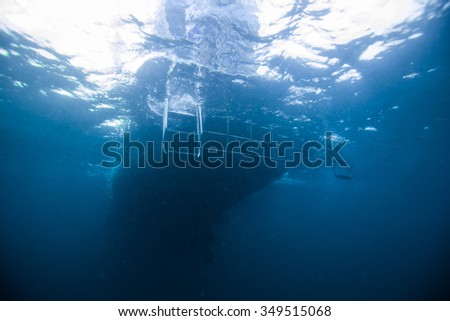 Underwater Blue Sea and diving boat  - stock photo