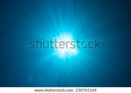 Underwater Blue Sunburst - stock photo