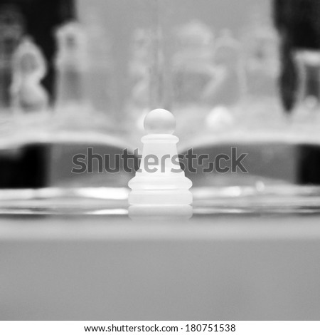 Underwater chess abstract with bubbles. Image has grain texture visible on its maximum size