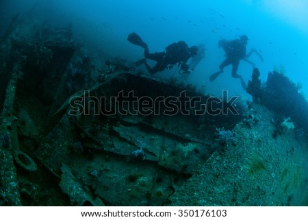 Underwater deep blue sea and scuba divers