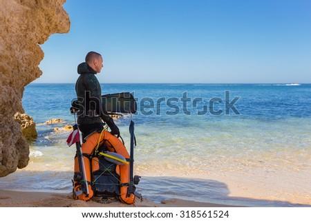 Underwater hunter preparing to dive. Underwater fishing in the Atlantic Ocean. - stock photo