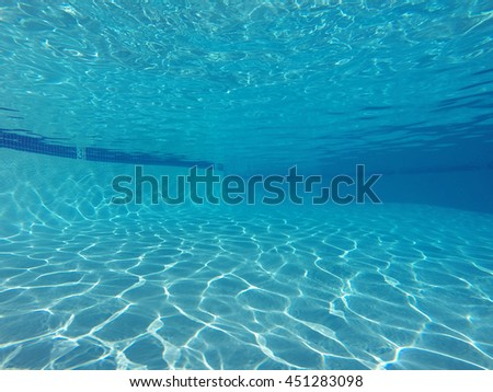 Underwater light patterns in clean empty suburban swimming pool.   - stock photo