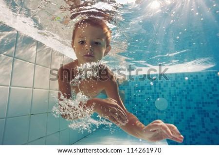 Underwater little kid close up portrait. - stock photo