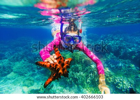 Underwater photo of girl with a starfish