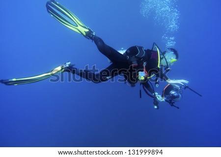 Underwater Photographer - stock photo