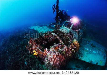 Underwater photography. Photographer diver scuba take a photo of Japanese sea plane, shot down during World War II. Actual under water Photo. 50 meters depth. Japan sea, Far East - stock photo