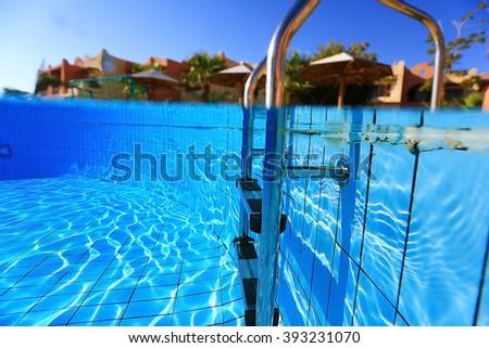 Underwater photos of the hotel resort pool - stock photo