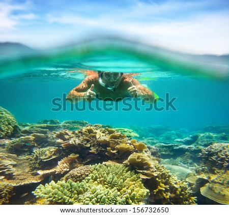 Underwater portrait of a man snorkeling coral reef  in tropical sea.. Vietnam - stock photo