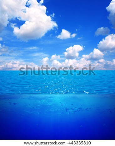 Underwater scene and blue sky with white clouds. Water surface split by waterline. 3d render - stock photo