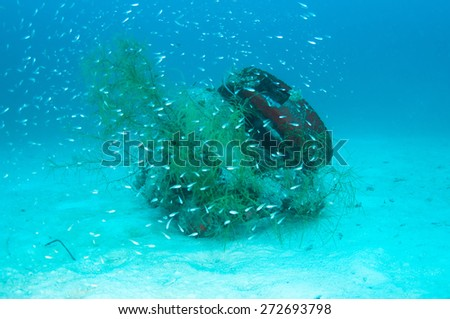 Underwater scene with tires artificial reef - stock photo