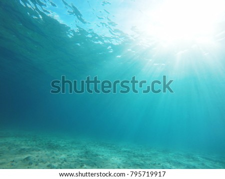 Underwater sea scene sunshine light through water