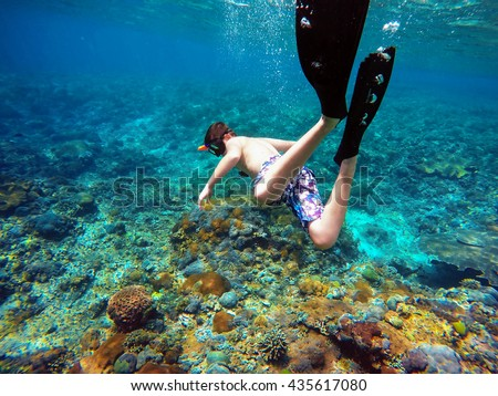 Underwater shoot of a young boy snorkeling and diving in a tropical sea in Nusa penida, Indonesia, Bali - stock photo